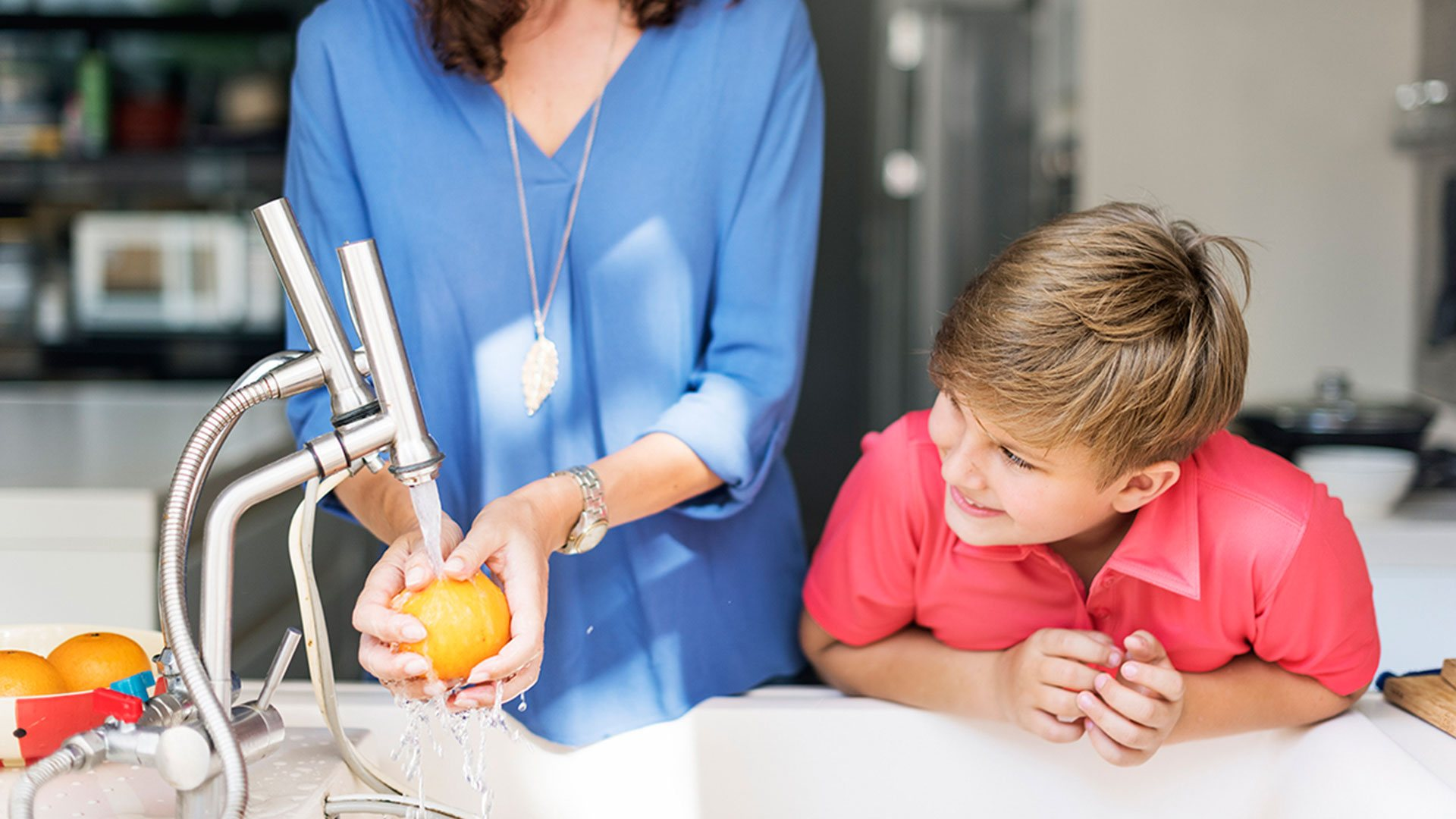 Mother and son washing fruit