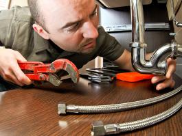 Man performing plumbing repairs
